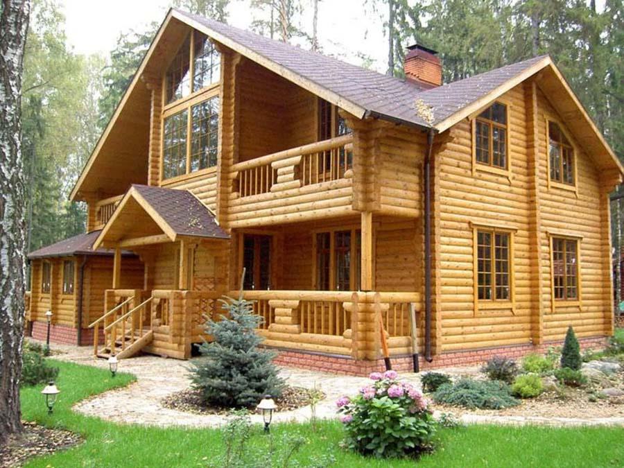 Дом из оцилиндр бревна